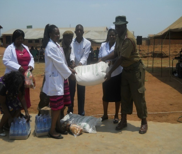 MoH and PACAM staff giving a bags of                                                 Bags of fortified flour.  fortified porridge flour to a prisoner warder.